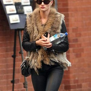 woman wearing fur gilet and jeans